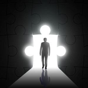 36960879 - silhouette of man on a background of the hole in the form of puzzles