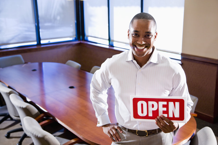 New entrepreneur holding open sign. He has just opened his new business